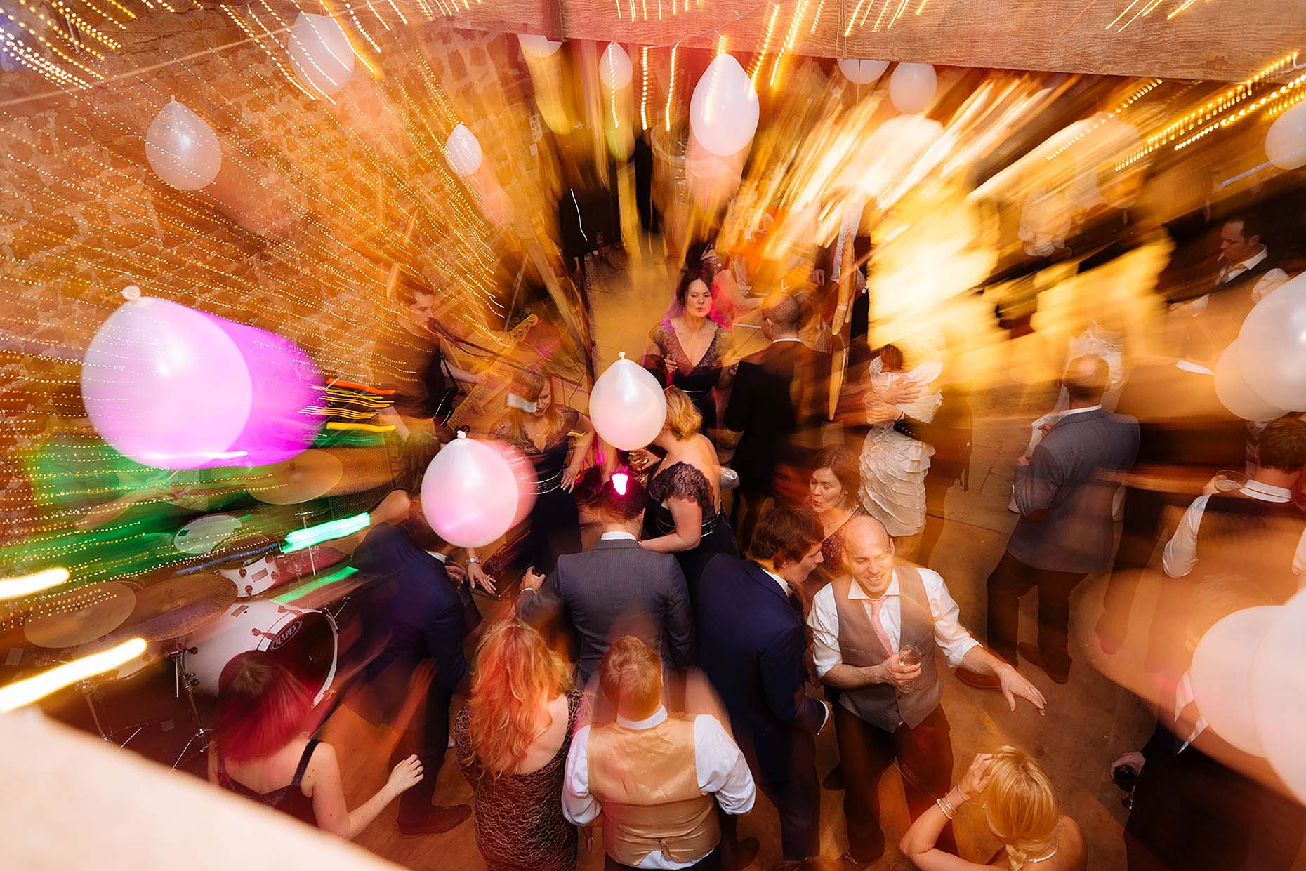 barn-wedding-night-dancefloor-zoomburst-colour-photography-08
