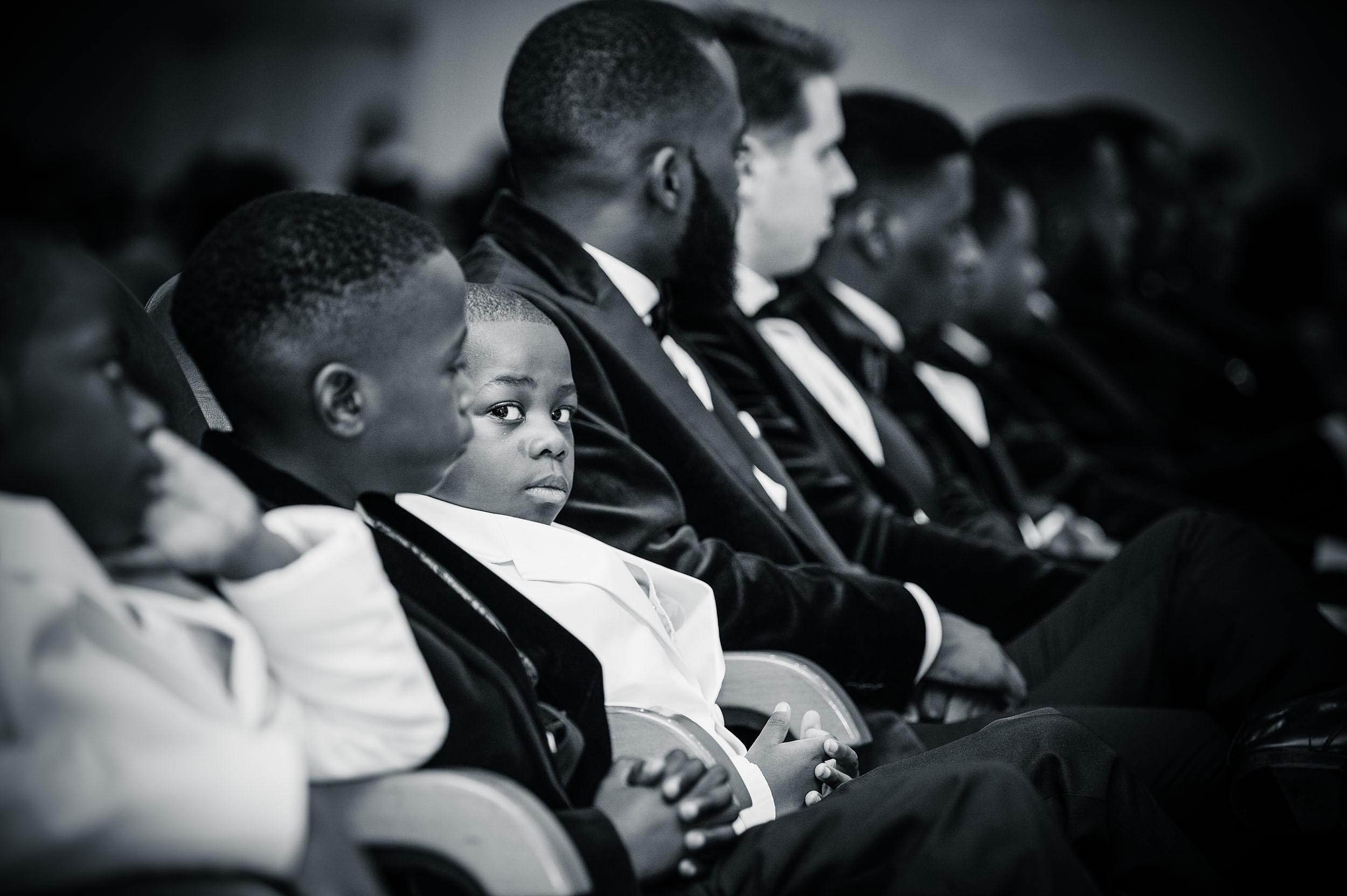 boy-sitting-wedding-ceremony-uckg-church-kilburn-north-london-photographer