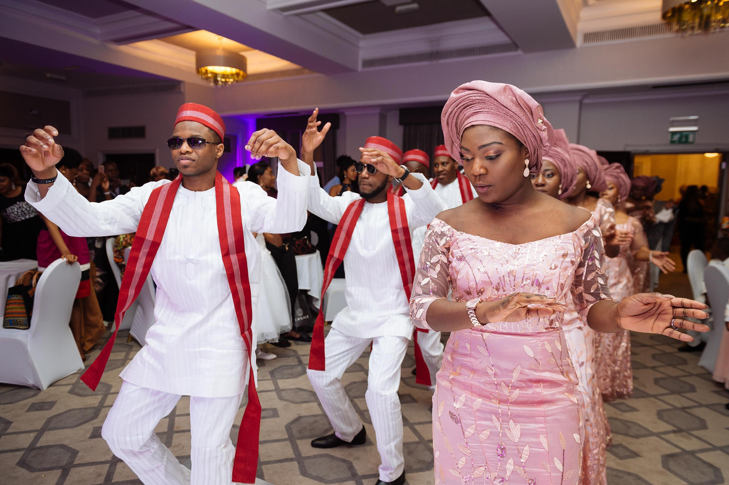 bridal-party-entrance-dancing-grand-connaught-rooms-london-reception-venue-african-wedding-photographer