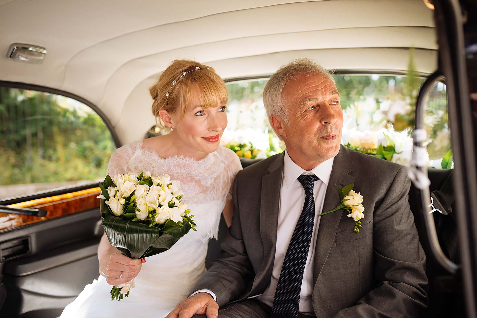 bride-father-car-arriving-church-stoke-newington-town-hall-wedding-photographer-02