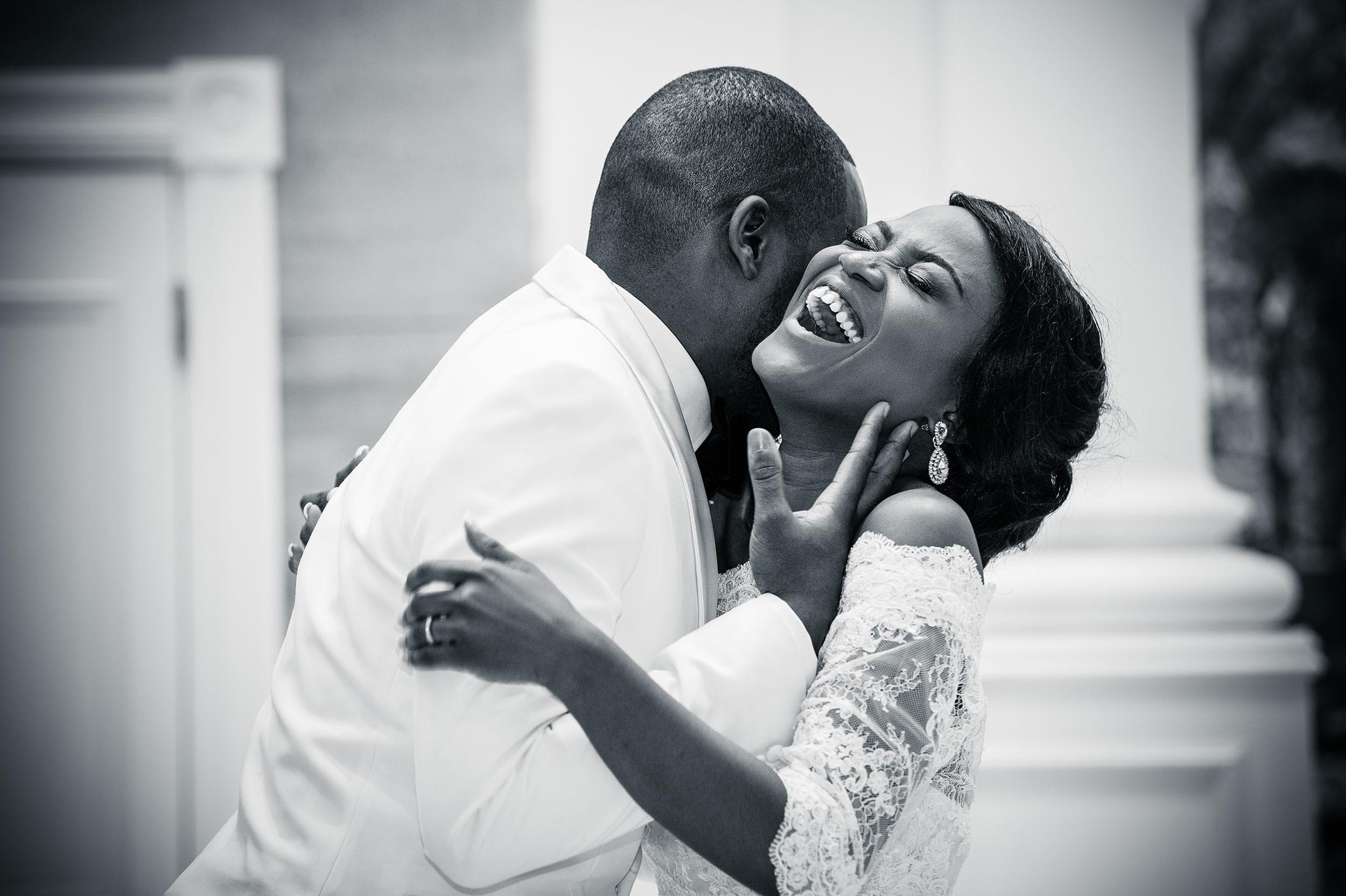 bride-groom-embrace-joy-love-uckg-kilburn-london-wedding-photographer