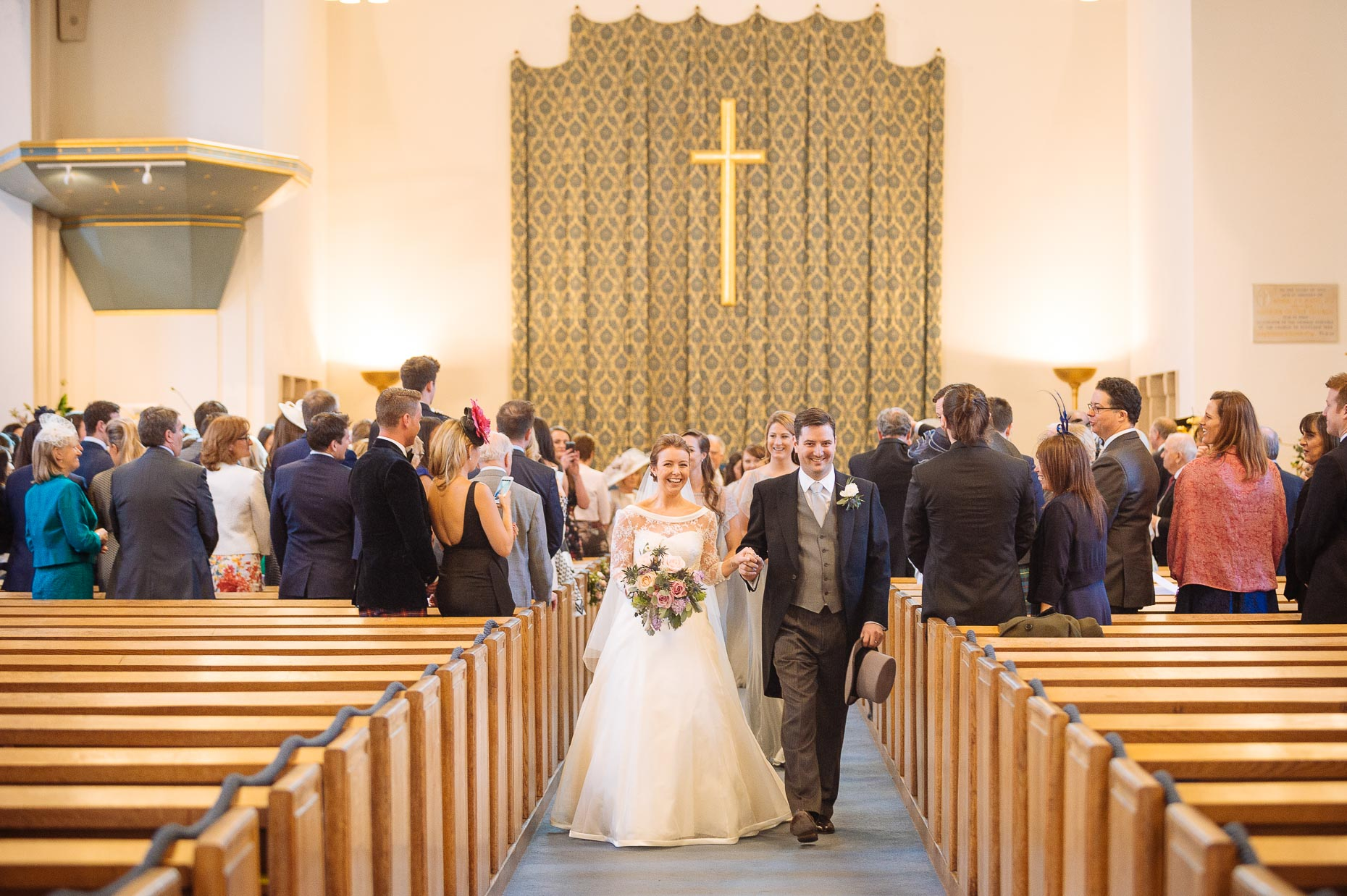 couple-down-the-aisle-st-columba-church-wedding-pictures-12