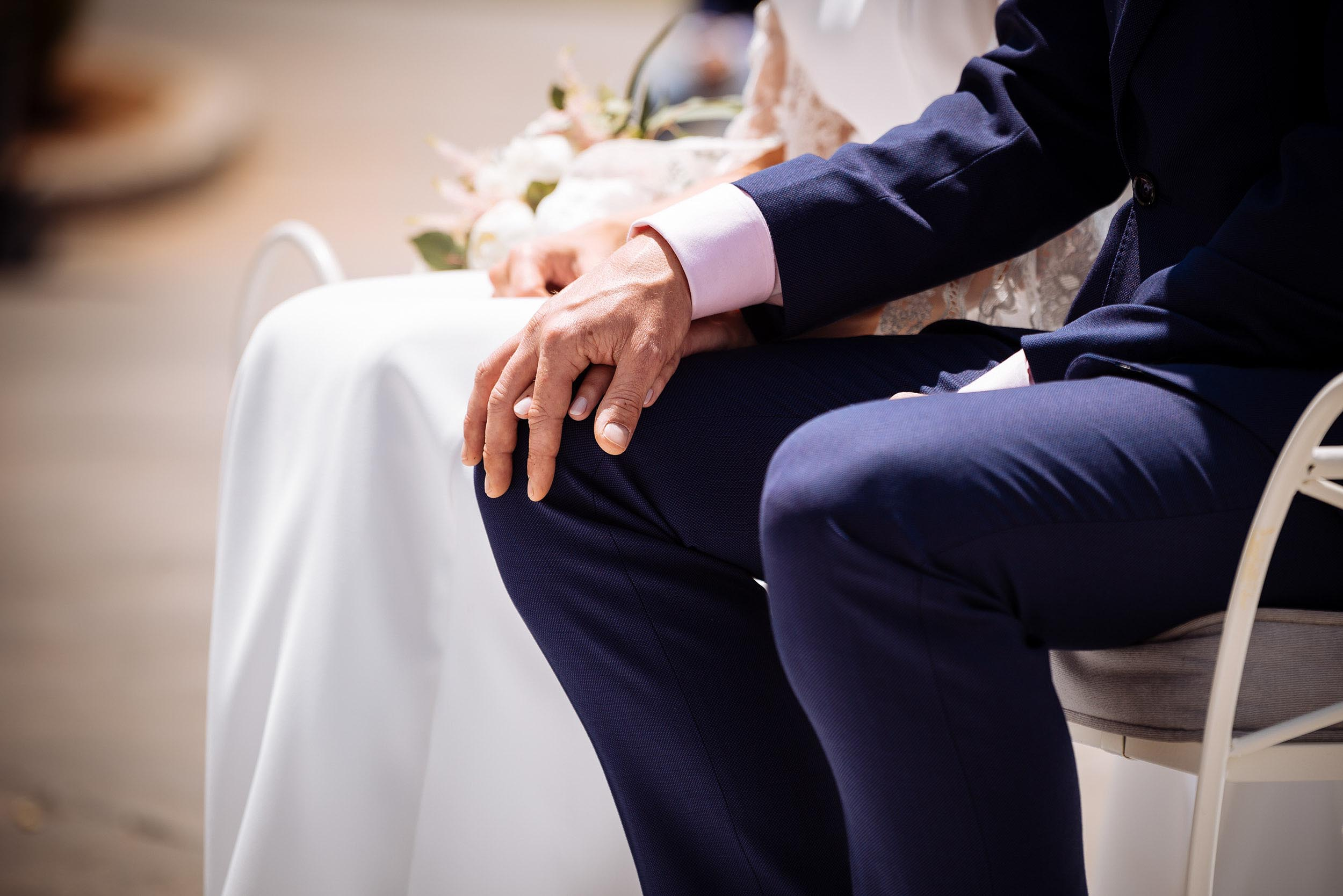 couple-holding-hands-wedding-ceremony-love-together
