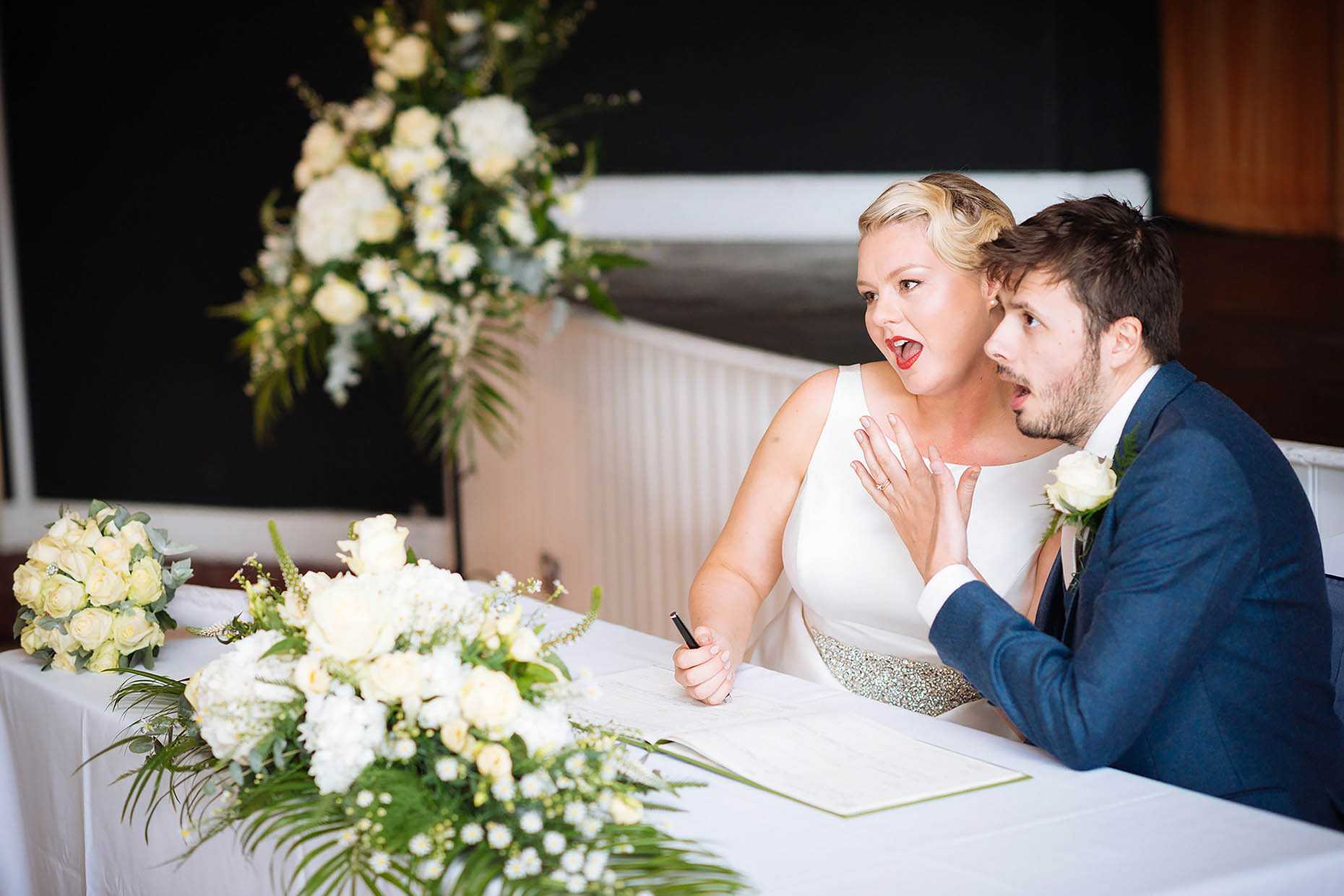 couple-strike-pose-signing-register-wedding-weymouth-newly-married-28