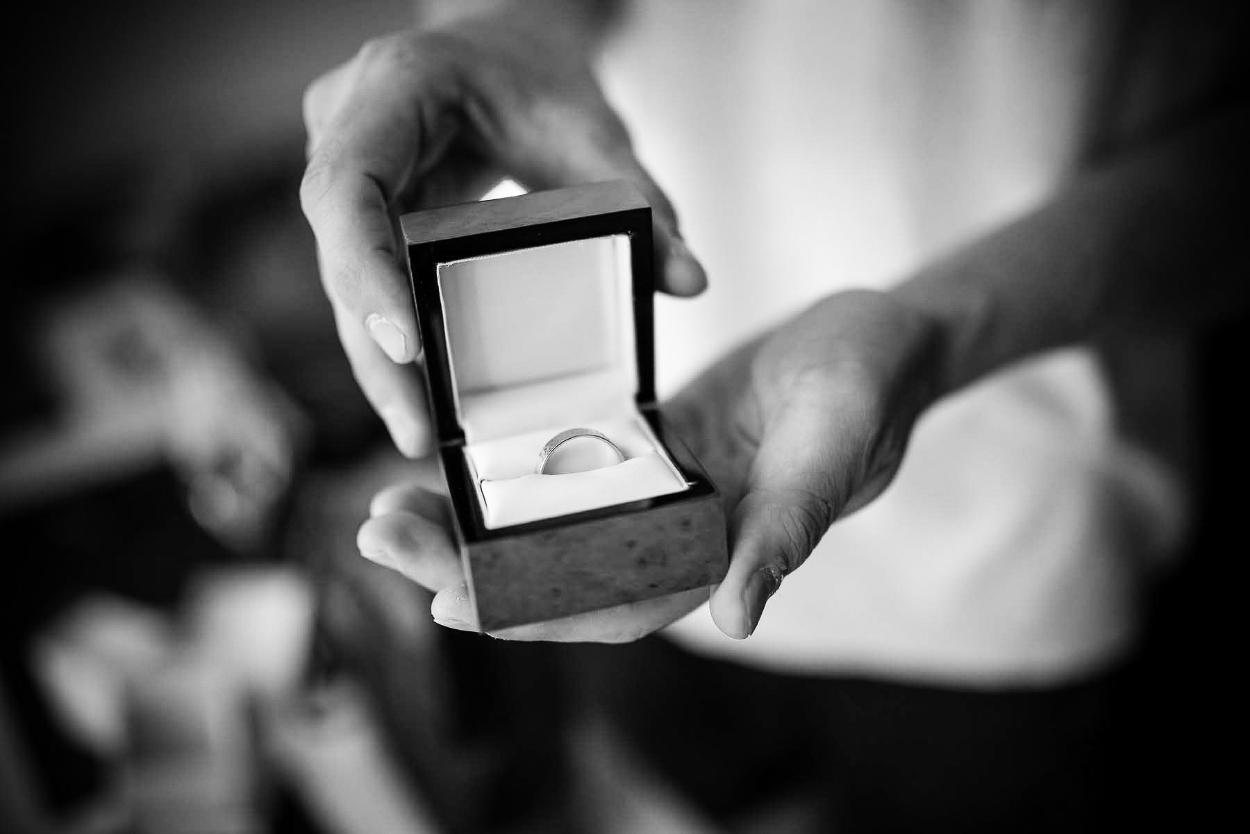 groom-showing-wedding-ring-box-black-and-white-reportage-photography-06