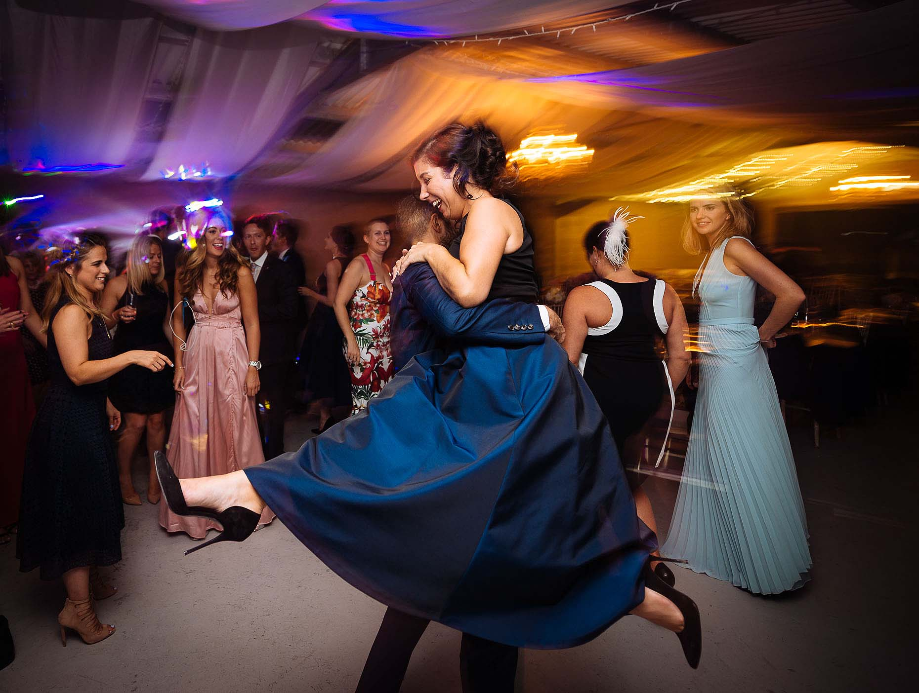 guests-dancefloor-night-motion-slow-sync-flash-technique-wedding-photography-26