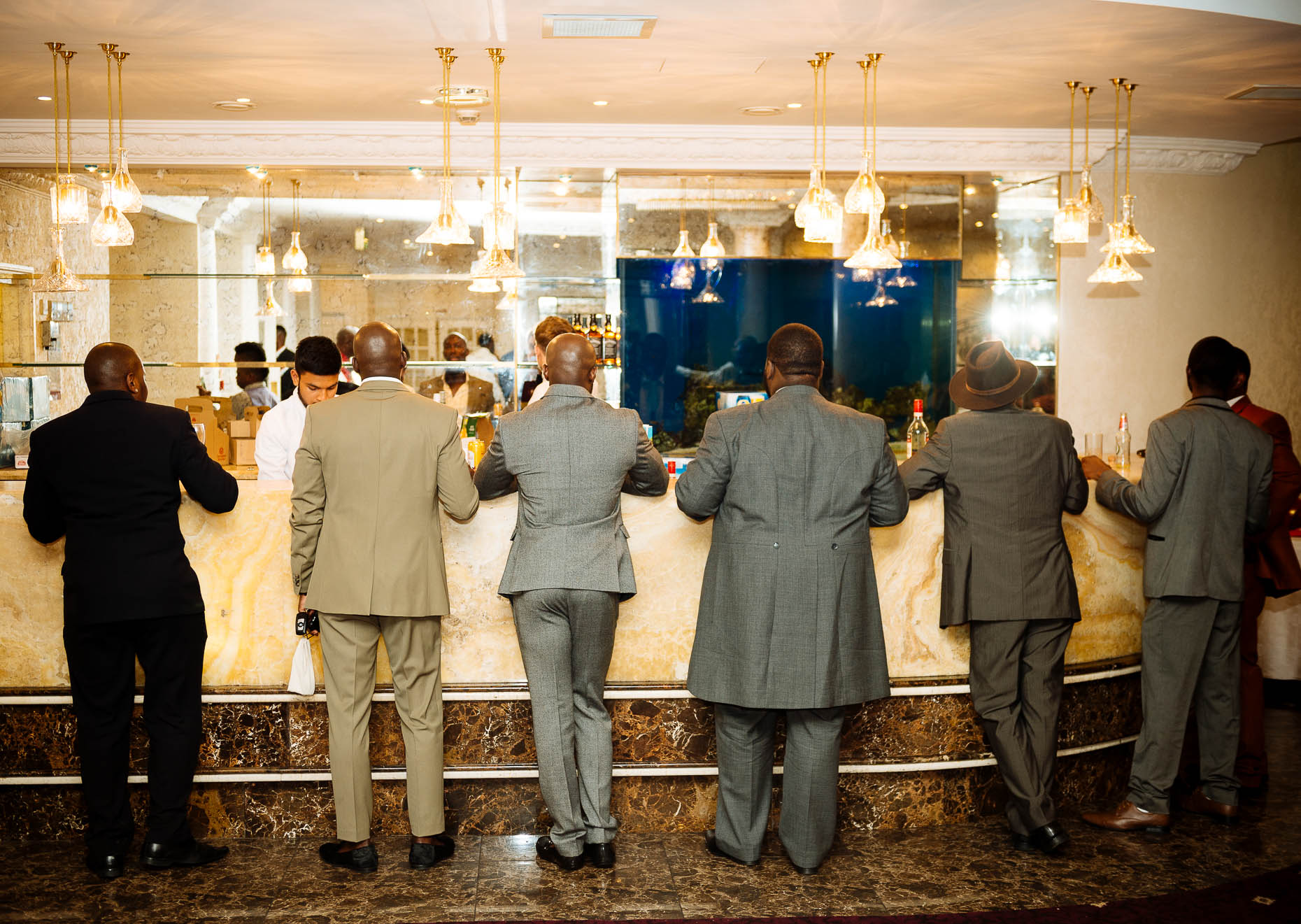 men-at-bar-suits-reportage-wedding-photographer-london-african-23