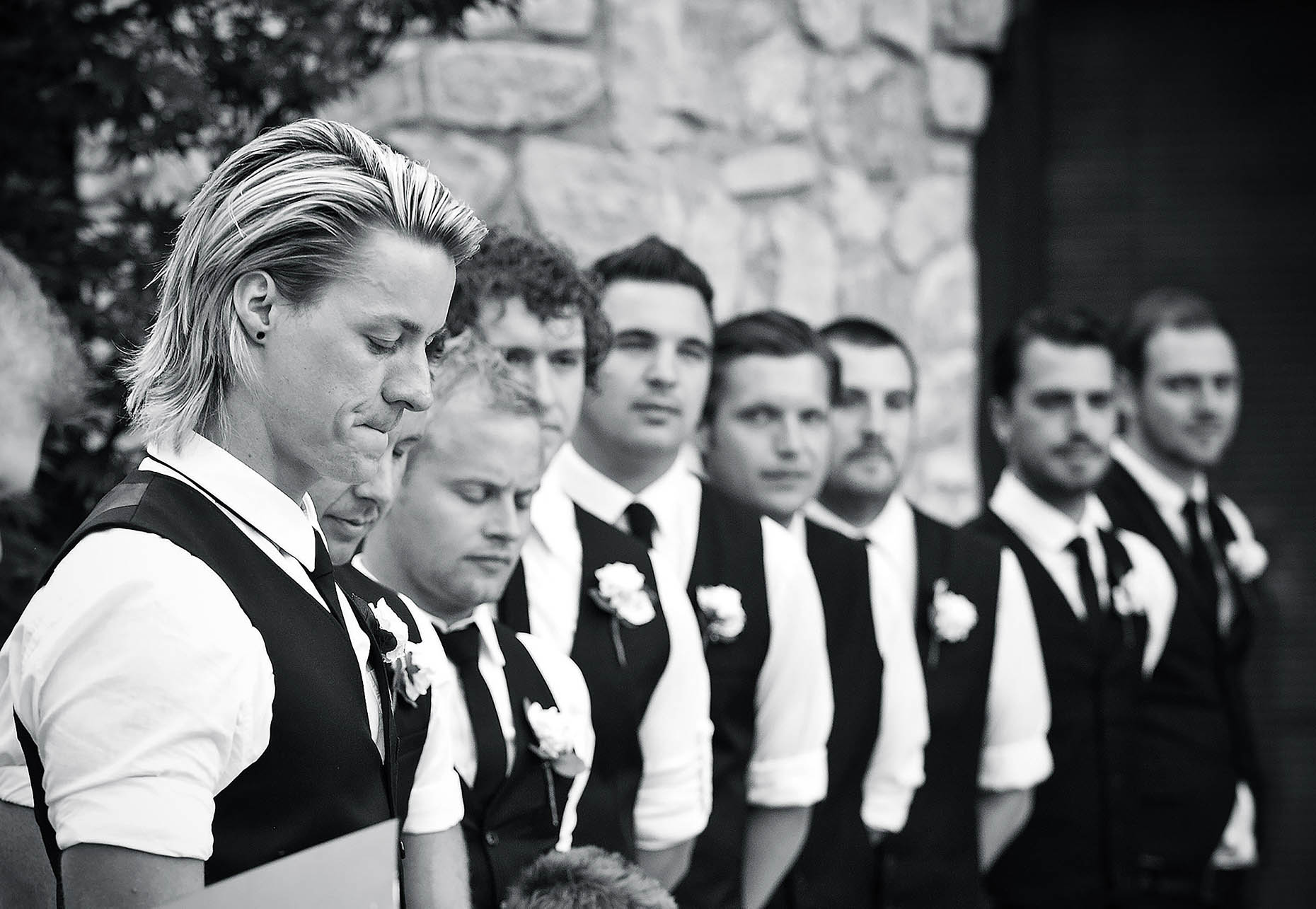 men-groom-ushers-line-ceremony-branson-missouri-weddings-black-white-07