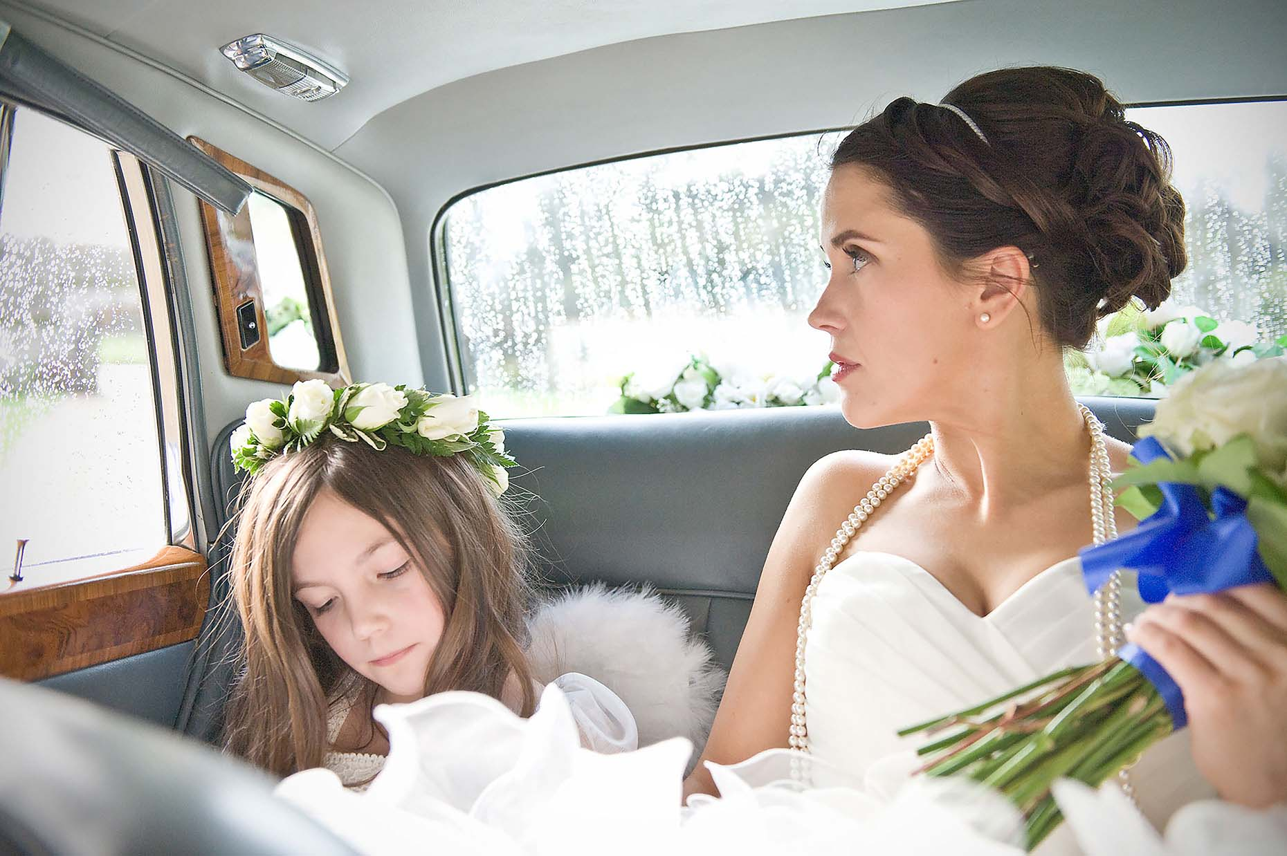 sarah-in-car-pensive-bride-before-wedding-ceremony-athelhampton-33