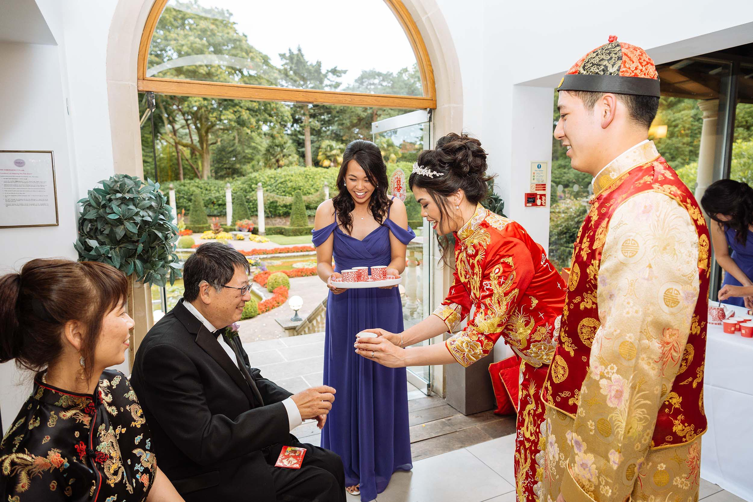 traditional-chinese-custom-on-wedding-day-gifts-family-father-recieving-italian-villa-dorset